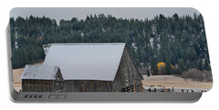 Portable Battery Charger featuring the photograph Snowy Barn Yellow Tree by Tom Gresham