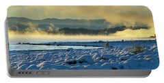 Portable Battery Charger featuring the photograph Snowy Shoreline Sunrise by Tom Gresham