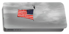 Portable Battery Charger featuring the photograph Socom Flag Jump In Selective Color by Doug Camara