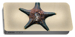 Starfish On The Beach Sand. Close Up. Portable Battery Charger