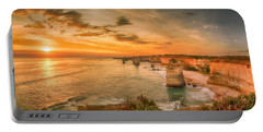 Portable Battery Charger featuring the photograph Sunset At The Twelve Apostles by Chris Cousins