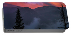 Sunset Storms Over The Rockies Portable Battery Charger