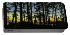Portable Battery Charger featuring the photograph Sunset Thru The Trees by Ed Clark