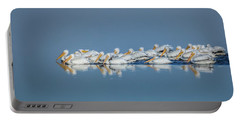 Portable Battery Charger featuring the photograph Swimming Pelicans by Dan Sproul