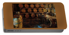 Portable Battery Charger featuring the photograph The Barrel Room by Thom Zehrfeld