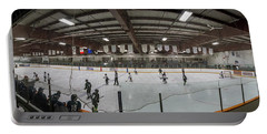 Portable Battery Charger featuring the photograph The Rink by Philip Rispin