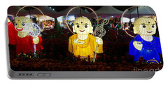 Three Lanterns In The Shape Of Buddhist Monks Portable Battery Charger