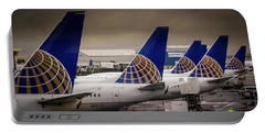 Portable Battery Charger featuring the photograph United Tails 02 by Philip Rispin