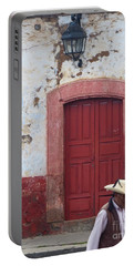 Portable Battery Charger featuring the photograph Walking By In Patzcuaro by Rosanne Licciardi