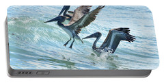 Wave Hopping Pelicans Portable Battery Charger