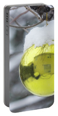 Portable Battery Charger featuring the photograph Yellow Christmas Ball Outside, Covered By Snow And House Reflect by Cristina Stefan
