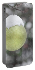Portable Battery Charger featuring the photograph Yellow Christmas Ball Outside, Covered By Snow. Outside Snowy Wi by Cristina Stefan