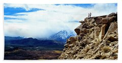 A Couple Stands On Top Of A Lava Butte Beach Towel
