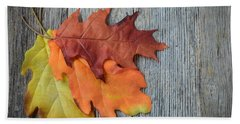 Autumn Leaves On Rustic Wooden Background Beach Towel