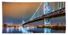 Ben Franklin Bridge And Philadelphia Skyline By Night Beach Towel