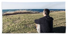 Caucasian Traveler Relaxing On Grass Outdoors Beach Towel