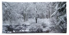 Fresh Snow Falls Along The Tree Lines Stream Beach Towel