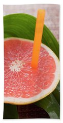 Half A Pink Grapefruit With A Straw Beach Towel