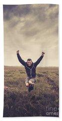 Holiday Man Jumping On Rural Australia Landscape Beach Towel