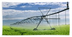 Irrigation Equipment On Farm Field Beach Towel