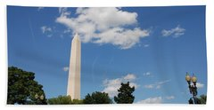 Obelisk Rises Into The Clouds Beach Towel