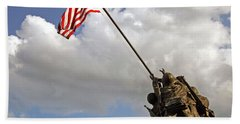 Beach Towel featuring the photograph Raising The American Flag by Cora Wandel