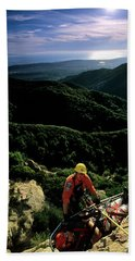 Search And Rescue Climber Tending Body Beach Towel