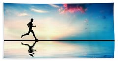 Silhouette Of Man Running At Sunset Beach Towel