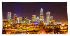 Beach Towel featuring the photograph Skyline Of Uptown Charlotte North Carolina At Night by Alex Grichenko