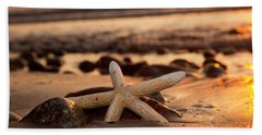 Starfish On The Beach At Sunset Beach Towel by Michal Bednarek