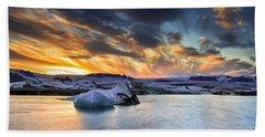 sunset at Jokulsarlon iceland Beach Towel