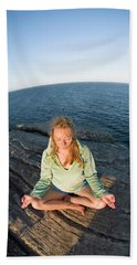 Yoga On Rocky Outcrop Above Ocean Beach Towel