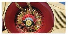 Beach Towel featuring the photograph 1933 Auburn 12-161a Custom Speedster Spare Tire Emblem by Jill Reger