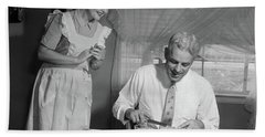 1950s Husband Eating Dinner As Wife Beach Towel