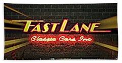 Fast Lane In Lights Beach Sheet by Kelly Awad