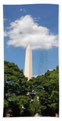 Obelisk Rises Into The Clouds Beach Sheet