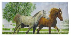Two Horses Running By White Picket Fence Beach Towel