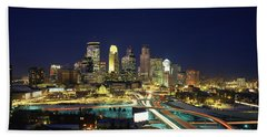 Buildings Lit Up At Night In A City Beach Towel