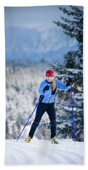 A Young Woman Cross-country Skiing Beach Towel