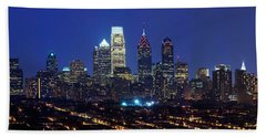 Buildings Lit Up At Night In A City Beach Towel by Panoramic Images