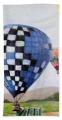 A Balloon Disaster Beach Towel by Donna Tucker
