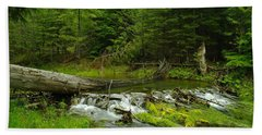 A Beaver Dam Overflowing Beach Towel by Jeff Swan