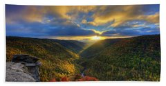 A Blue And Gold Sunset Beach Towel by Dan Friend