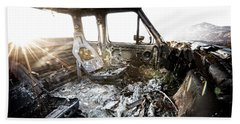 A Burned Out Truck At Sunset Beach Towel