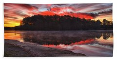 A Christmas Eve Sunrise Beach Towel by Gordon Elwell