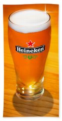 A Cold Refreshing Pint Of Heineken Lager Beach Towel by Semmick Photo