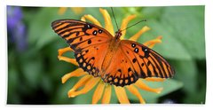 A Gulf Fritillary Butterfly On A Yellow Daisy Beach Towel by Eva Kaufman