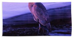 A Heron On The Moyie River Beach Towel by Jeff Swan