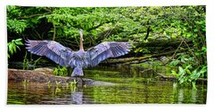 Beach Towel featuring the photograph A Heron Touches Down by Eleanor Abramson