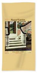 A House And Garden Cover Of A Cat On A Staircase Beach Towel